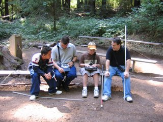 Kevin, Chris, Adam and Gibbie, left to right, on a bench in the woods