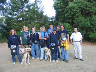 Twelve people and 3 Seeing Eye dogs, including brother and Sister, Miguel and Missy, atop Sunrise Hill