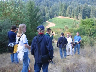Eight WayFun folks on a trail overlooking the Quail Ridge vineyard in route back from Sunrise Hill