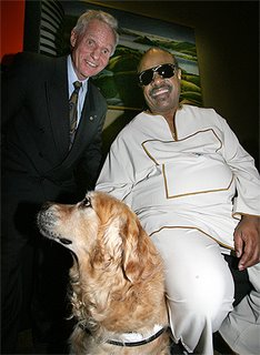 MEET AND GREET: Stevie Wonder meets Royal New Zealand Foundation for the Blind chairman Don McKenzie and his guide dog Senna.
