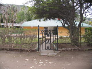 The front gate of Mike's grandfathers house, with the circle J