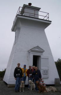 Group in front of lighthouse