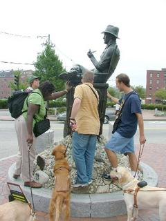 Jan, Denna, Brian and Adam touching the statue of John Ford