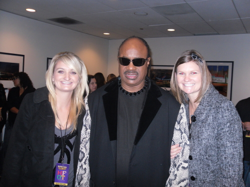 Jamie and Katie Adams with Stevie Wonder at the House Full of Toys benefit concert