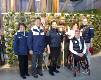 the delegation group in front of the living wall