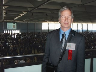 Mike on a balcony overlooking a sea of cadets