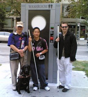 Gil, Kevin and Greg standing in front of their latest geocaching treasure