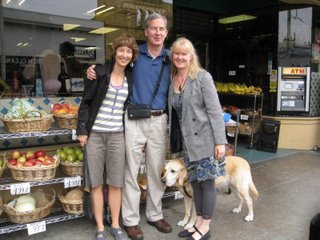 Roxanne, Mike and Sheri in front of a store front