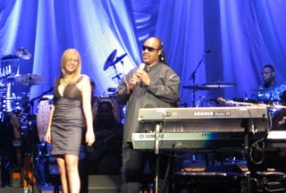 Sara Beck and Stevie Wonder performing at the Sommet Center