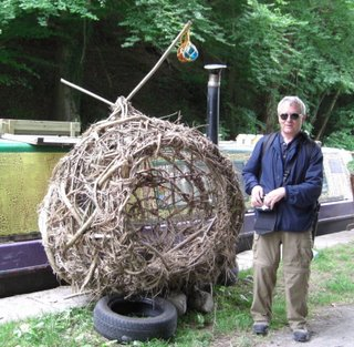 this ball woven of twigs is large enough to climb into and is for sale