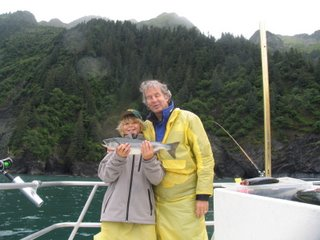 Mike and Wyndham with the fish that Wyndham caught