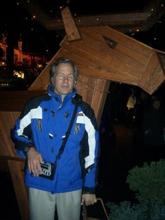Mike at Tivoli Gardens in front of a wooden reindeer