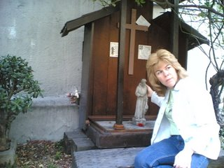Ginger touching the St. Francis Statue