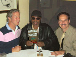 Mike celebrating the release of Crashing Through with Stevie Wonder and long time friend and colleague Rob Reis