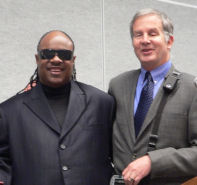 Mike and Stevie Wonder presenting awards for Accessible products at CES 2009